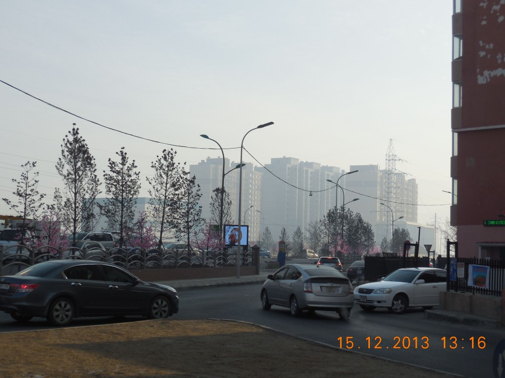 Again, a new apartment complex with shopping - and smog - in the distance.